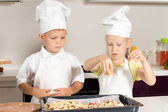 Little Chefs Putting Cheese on Pizza Seriously — Stock Photo