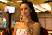 Beautiful woman sipping champagne — Stock Photo