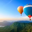 Colorful hot-air balloons flying — Stock Photo #18366535
