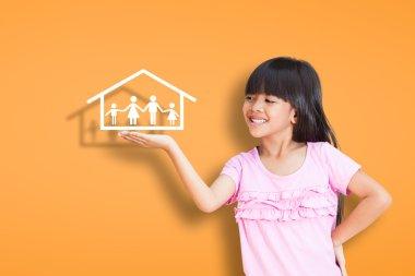 Smiling little girl showing on family symbol