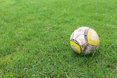 Old Soccer ball in Lawn — Stock Photo