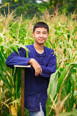 Teenager boy in thailand's farmer dresss at corn field — Stock Photo