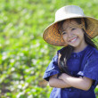 Little smiling girl farmer on green fields — Stock Photo