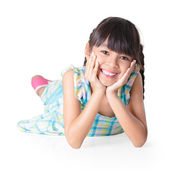 Portrait of a cute happy little asian girl laying on floor — Stock Photo