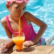Little asian girl in the swimming pool — Stockfoto
