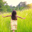 Happy little girl running on meadow — Stock Photo #26596813