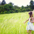 Little asian girl walking outdoors in a meadow — Stock Photo