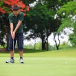Golf teenager boy player green putting — Stock Photo