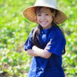Smiling little girl in thai's farmer dress — Stock Photo