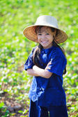 Smiling little girl in thai's farmer dress — Stock Photo