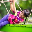 Happy little asigirl on playground — Stock Photo #27837229