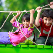 Happy asian child playing together on playground — Stock Photo