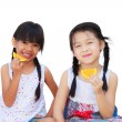 Two little girls showing slices of orange — Stock Photo