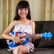 Little asian girl playing ukulele — Stock Photo
