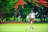 Smiling asian woman golfer — Stock Photo
