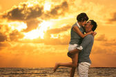 Young asian couple in love staying and kissing on the beach — Stock Photo