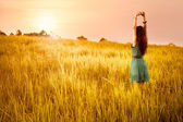 Happy young asian woman standing in meadows — Stock Photo