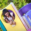 Smiling little asian girl enjoys playing — Stock Photo