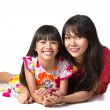 Happy mother and daughter laying on the floor — Stock Photo