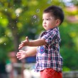 Baby boy with soap bubbles — Stock Photo