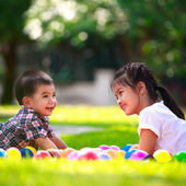 Two children are laying on green grass and smile — Stock Photo