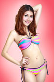 Pretty swimsuit fashion young asian woman posing on pink backgro — Stock Photo