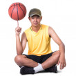 Teenager boy sitting with basketball — Stock Photo