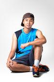 Teenager boy sitting — Stockfoto