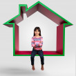 Little asian girl sitting on virtual home 3D — Stock Photo