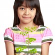 Little asian girl with seedling growth from coins — Stock Photo #33613923