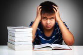 Angry asian boy with learning difficulties — Stock Photo
