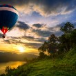 Hot air balloons floating over lake — Stock Photo #34125385