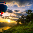 Stock Photo: Hot air balloons floating over lake