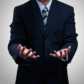 Businessman open hands showing something — Stock Photo