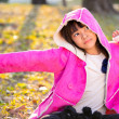 Stock Photo: Sad beautiful little girl in pink coat