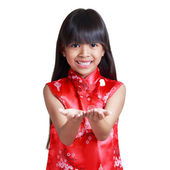 Smiling little asian girl with cheongsam respecting — Stock Photo