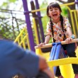 Asian little girl enjoys playing in a children playground — Stock Photo
