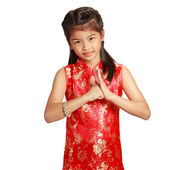 Smiling little asian girl with cheongsam respecting on chinese n — Stock Photo