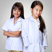 Little asian girls in medical profession — Stok fotoğraf