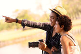 Happy asian couple tourists in nature — Stock Photo