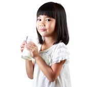 Happy little asian girl holding a cup of milk — Stock Photo