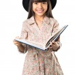Smiling asian little girl with a book in hand — Stock Photo #44852621