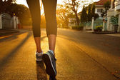Woman with an athletic pair of legs going for a jog — Stock Photo