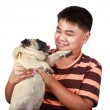 Young asian boy playing with his dog — Stock Photo #46141071