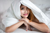 Young asian woman in bed — Stock Photo