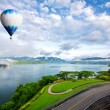 Hot air balloon ffloating over dam — Stock Photo #48417007