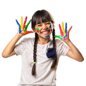 Little asian girl with her hands in the paint — Stock Photo