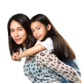 Happy mother and daughter playing — Stock Photo