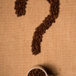 Coffee beans on burlap (question mark) — Stock Photo