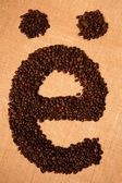 E, Alphabet from coffee beans on white background. — Stock Photo